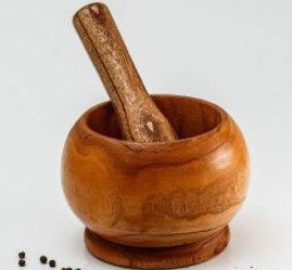 Mincing Ginger With a Mortar and Pestle